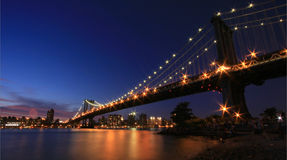 Manhattan Bridge at Night. From Brooklyn with NY skyline Stock Images