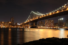 Manhattan Bridge at Night. View from beside the Manhattan Bridge of lower Manhattan skyline Stock Photos