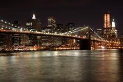 Manhattan Bridge at Night. View from beside the Brooklyn Bridge of lower Manhattan skyline Stock Photos