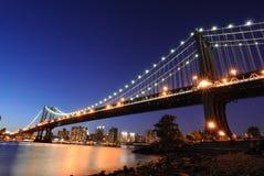 Manhattan Bridge at Night. The Manhattan Bridge illuminated at night spanning the East River in New York city Stock Photos