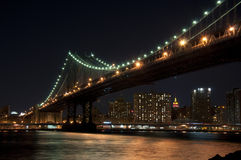 Manhattan bridge at night. The Manhattan Bridge illuminated at night spanning the East River in New York city Royalty Free Stock Photo