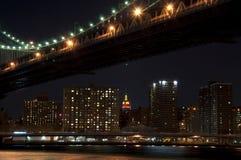 Manhattan bridge at night. The Manhattan Bridge illuminated at night spanning the East River in New York city Royalty Free Stock Image