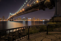 Manhattan Bridge At Night. With Downtown in the background Royalty Free Stock Photo