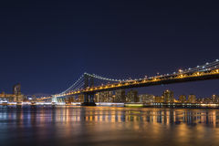 Manhattan Bridge at night. Stock Photos