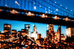 Manhattan Bridge At Night. Blurred lights of Manhattan Skyline and Manhattan Bridge At Night. Manhattan Bridge is a suspension bridge that crosses the East River Royalty Free Stock Photo