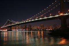 Manhattan Bridge at Night. Lights of Manhattan and the Manhattan Bridge in New York City Stock Images