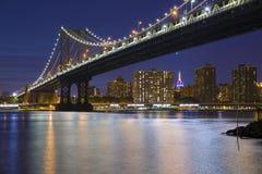 Manhattan Bridge At Night. New York City Skyline and Manhattan Bridge At Night Stock Photo