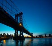 Manhattan Bridge At Night. Manhattan Skyline and Manhattan Bridge At Night with copyspace. Manhattan Bridge is a suspension bridge that crosses the East River in Stock Photos