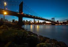 Manhattan Bridge At Night. Manhattan Skyline and Manhattan Bridge At Night. Manhattan Bridge is a suspension bridge that crosses the East River in New York City Stock Photography