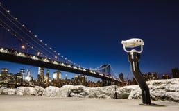 Manhattan Bridge At Night. White binoculars on an observation platform near Manhattan Bridge At Night Stock Photo