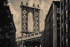 The Manhattan Bridge and an old Brooklyn street  in New York Stock Photography