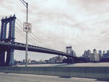 Manhattan bridge over the river and the speed limit sign in vintage style Royalty Free Stock Images