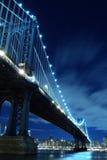Manhattan Bridge and Skyline At Night Stock Photo