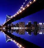 Manhattan Bridge and skyline at Night Stock Image