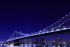 Manhattan Bridge and skyline At Night Royalty Free Stock Images