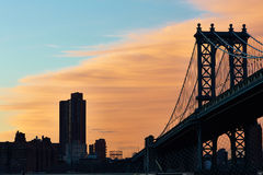 Manhattan Bridge and skyline silhouette view from Brooklyn at sunset Stock Images