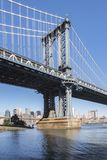 Manhattan Bridge Tower from Brooklyn early in the morning with blue sky and sun shine. 30th of July 2017 - Brooklyn, New York, NY, United States of America Royalty Free Stock Photo