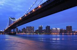 Manhattan Bridge at twilight. Manhattan Bridge and NYC at twilight Royalty Free Stock Photography