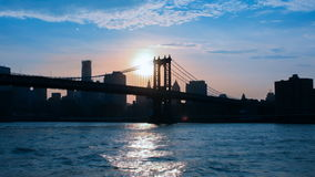 Manhattan bridge view from East river at dusk sunset. stock footage