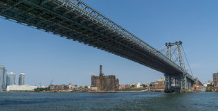 Manhattan Bridge View from Underneath Right. The view from underneath the Manhattan Bridge in New York City, from the East River looking towards Manhattan, a stock photo
