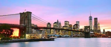 Manhattan and Brooklyn Bridge at dusk. Stock Photos