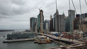 The Manhattan from Brooklyn Bridge royalty free stock photos