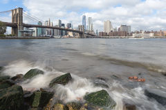 Manhattan and Brooklyn Bridge from the Hudson river. Manhattan skyline and Brooklyn Bridge with waves ot the Hudson river Stock Photography
