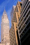 Manhattan Buildings. This image was shot in Manhattan, New York City, New York and shows a cluster of office buildings including the Chrysler Building. The image Royalty Free Stock Images