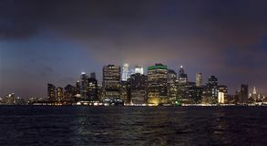 Manhattan buildings viewed from Brooklyn side and East river New Royalty Free Stock Images