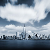 Manhattan cityscape in blue color with blurred sky Royalty Free Stock Photography