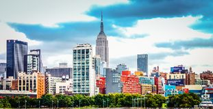 Manhattan Cityscape from the Hudson River along Pier 62 and Chelsea Waterside Park. Royalty Free Stock Images