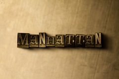 MANHATTAN - close-up of grungy vintage typeset word on metal backdrop Royalty Free Stock Images