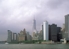 Manhattan on a cloudy day. The Manhattan Island on a cloudy day. View from the Staten Island Ferry Royalty Free Stock Photography