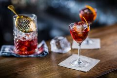 Manhattan cocktail drink decorated on bar counter in pub or rest. Aurant Royalty Free Stock Photos