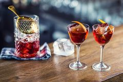 Manhattan cocktail drink decorated on bar counter in pub or rest. Aurant stock photos