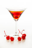 Manhattan cocktail garnished with a cherry. On white background Royalty Free Stock Photo