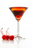 Manhattan cocktail garnished with a cherry. On white background Stock Image