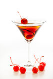 Manhattan cocktail garnished with a cherry. On white background Stock Images