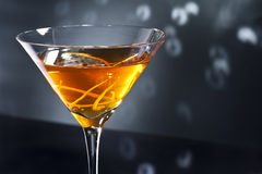 Manhattan cocktail. Over black and bright sparkles Royalty Free Stock Photo