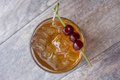 Manhattan Cocktail. On the rocks garnished with cherries Stock Images