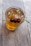 Manhattan Cocktail. On the rocks garnished with cherries Stock Photography