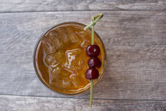 Manhattan Cocktail. On the rocks garnished with cherries Royalty Free Stock Photo