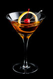 Manhattan cocktails on black background with garnish Stock Photography