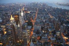Manhattan in de avond Stock Foto