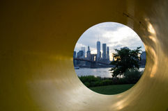 Manhattan Downtown Financial District Skyline and Brooklyn Bridge as Seen Through Yo Sculpture from Mainstreet Park in Brooklyn Royalty Free Stock Photo