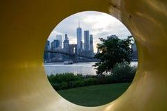 Manhattan Downtown Financial District Skyline and Brooklyn Bridge as Seen Through Yo Sculpture from Mainstreet Park in Brooklyn Stock Image