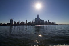 Manhattan downtown skyline with freedom tower, from Hudson river. In a sunny day Stock Images
