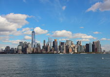 Manhattan Downtown Skyline from Seaside with Blue Sky Stock Images