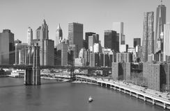 Manhattan Downtown Skyline. View from the Manhattan bridge at the skyline of New York downton Manhattan, with the waterside of the east river and part of the royalty free stock photo