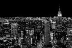 Manhattan en la noche Fotos de archivo libres de regalías